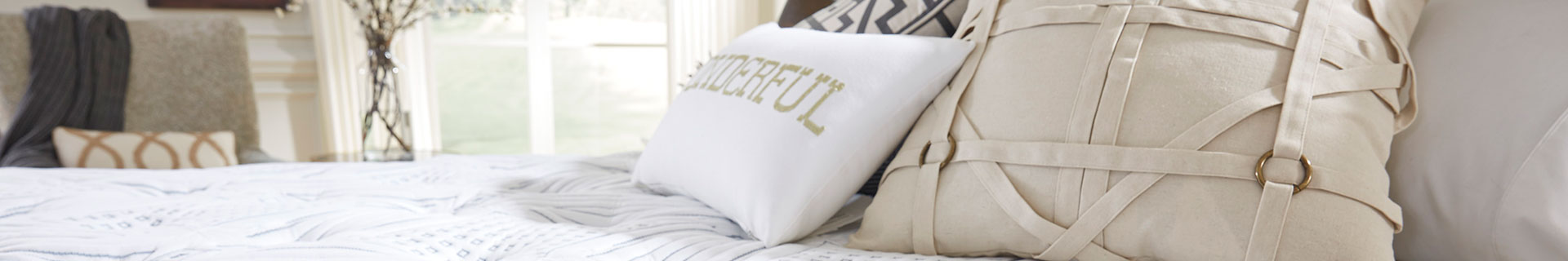 Bed with throw pillow.